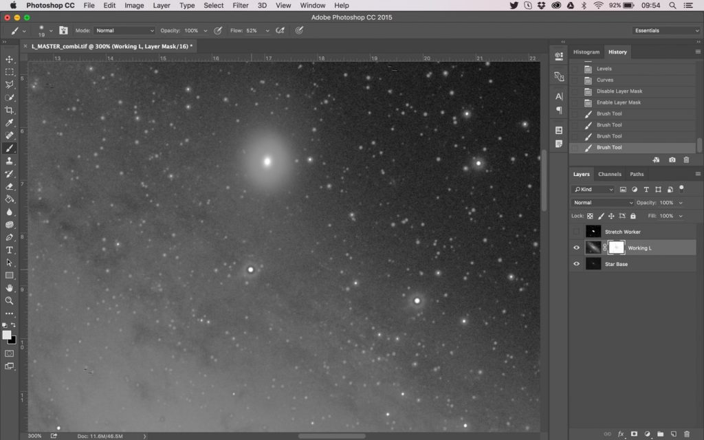 In the layer mask, use the brush to touch up DSO elements and bright stars, removing dark halos from the mask.