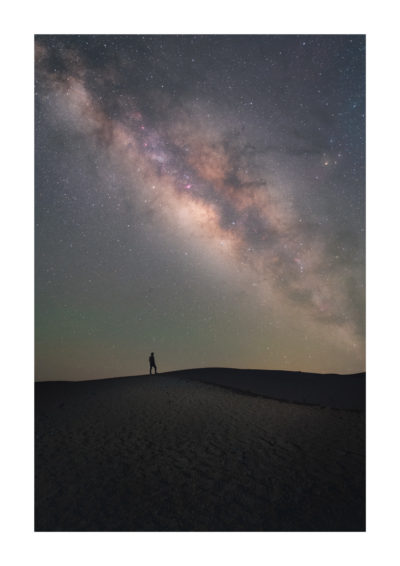 The Milky Way rising above a lone stargazer, in Minas de San Jose, Teide National Park in Tenerife. Available as a print on my store